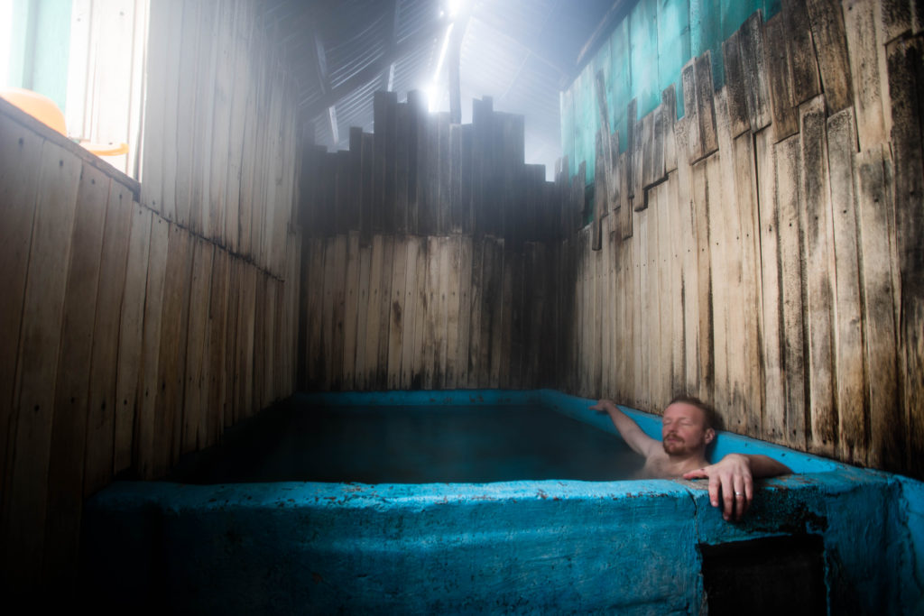 Stephen Lioy soaking at the Altyn Arashan hot spring (Copyright Stephen Lioy - Photography and Travel Media)